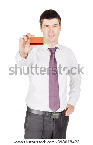 portrait of young smiling business man holding credit card.  isolated on white background. technology, shopping, banking and lifestyle concept