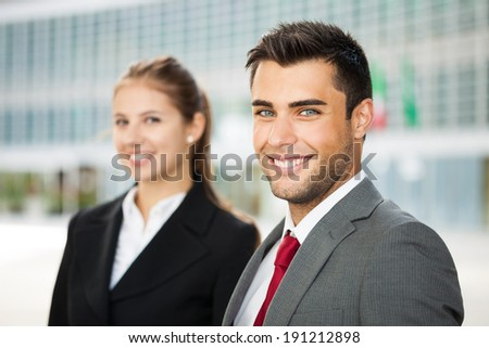 Portrait of young smiling business people - stock photo