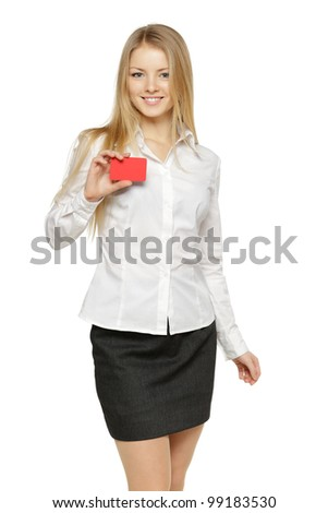Portrait of young smiling business woman holding credit card isolated on white background