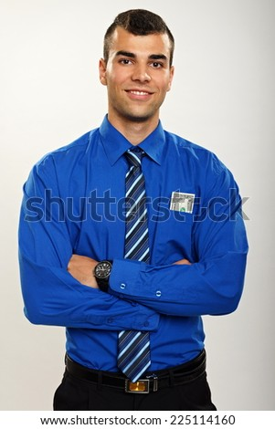 Portrait of young smiling businessman with one dollar in his pocket - stock photo