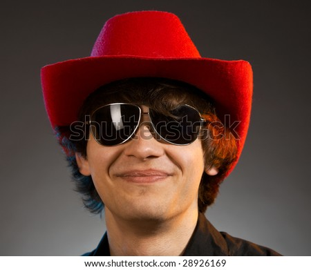 portrait of young smiling caucasian man over grey background - stock photo