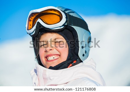 Portrait of young smiling girl a ski outfit at winter outdoor. Tirol, Austria - stock photo