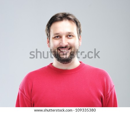 Portrait of young smiling man - stock photo