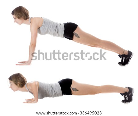 Portrait of young smiling slim beautiful woman doing fitness exercises on mat, warming up, push-ups, full length isolated studio image on white background, side view