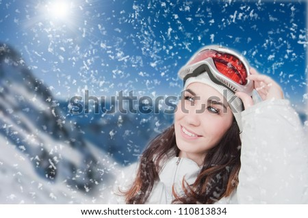 Portrait of young smiling woman against a background of the mountains - stock photo