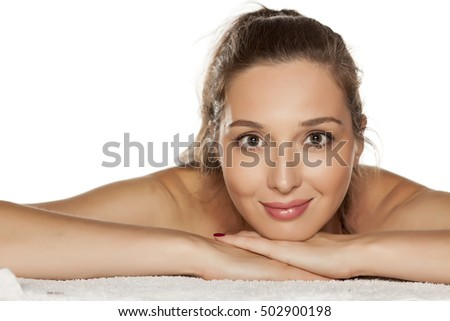 portrait of young smiling woman leaning on her hands