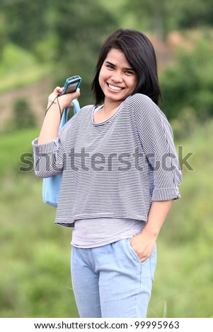 Portrait of young smiling woman outdoor