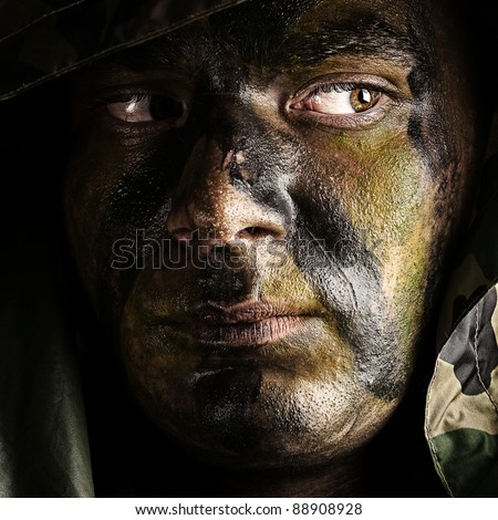 portrait of young soldier face with hood - stock photo