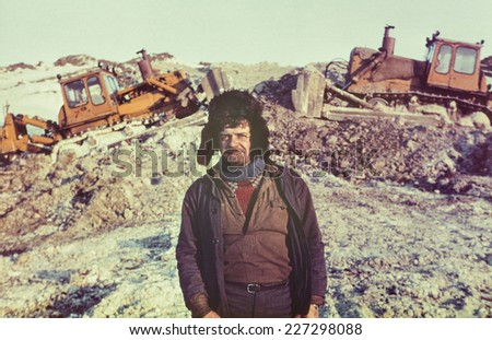 Portrait of young soviet gold-prospector - Vintage photo taken on a gold-field in tundra, Chukchi Peninsula, USSR, July 1984 - stock photo