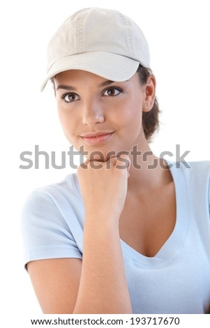 Portrait of young sporty girl in baseball cap. - stock photo