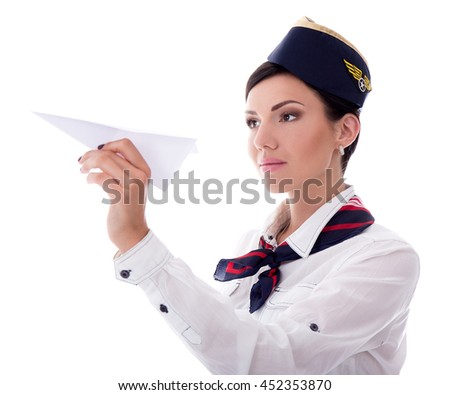 portrait of young stewardess holding paper plane isolated on white background - stock photo
