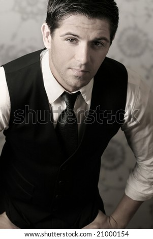 Portrait of young stylish businessman in tie and vest - stock photo