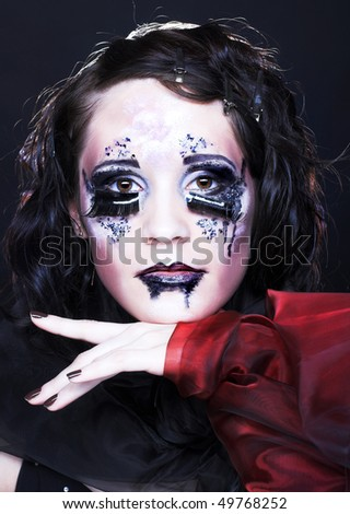 Portrait of young stylish lady with creative make-up