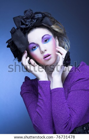 Portrait of young stylish woman in violet dress and little black hat - stock photo