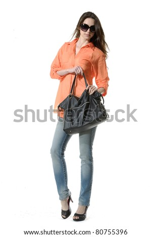 Portrait of young stylish woman with handbag on white background