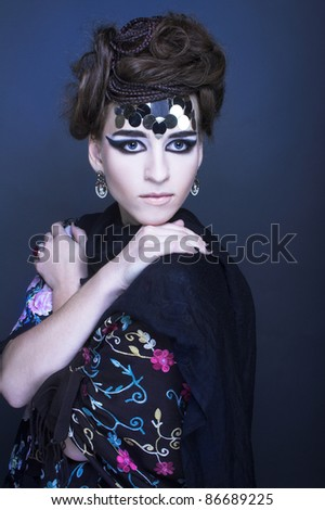 Portrait of young stytisn woman with creative visage. - stock photo