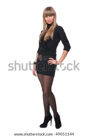 Portrait of young sure business woman in black dress and stocking