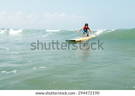 portrait of young surfers enjoying his action at ocean - stock photo