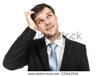 Portrait of young thoughtful businessman scratching his head isolated over white background - stock photo