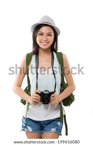 Portrait of young tourist with camera and backpack - stock photo