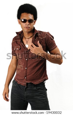 Portrait of young trendy african american man standing - stock photo