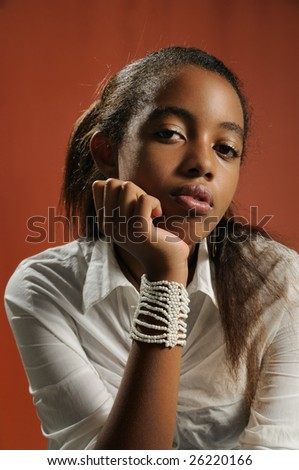 Portrait of young trendy african american teen girl posing with serious expression - stock photo