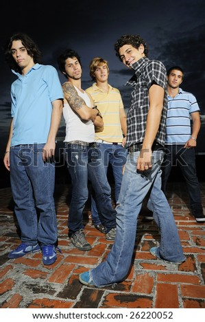 Portrait of young trendy group of friends with attitude - stock photo
