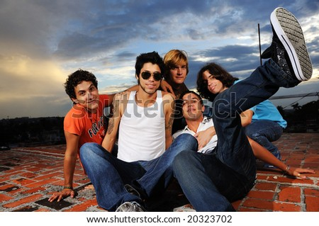 Portrait of young trendy group of male friends having fun