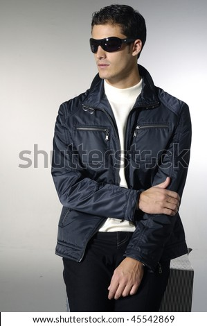 Portrait of young trendy male model wearing sunglasses - stock photo