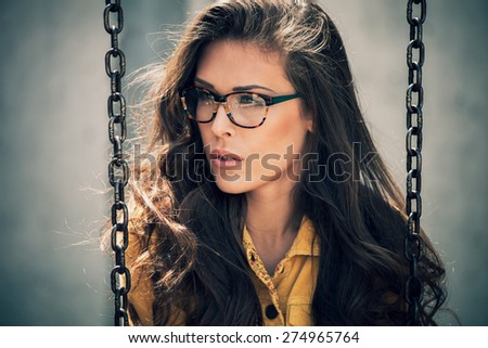 portrait of young urban woman with eyeglasses, outdoor shot - stock photo