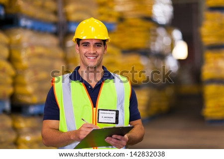 portrait of young warehouse worker indoors - stock photo