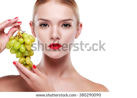 Portrait of young white-headed girl with fruit isolated on a white background - stock photo