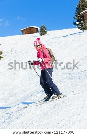 Portrait of young woman a ski outfit at winter outdoor. Tirol, Austria - stock photo