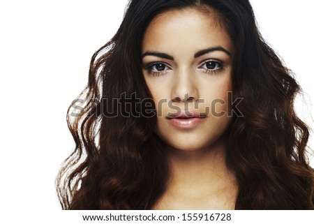 Portrait of young woman against white background - stock photo