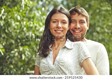 Portrait of young woman and her lover - stock photo
