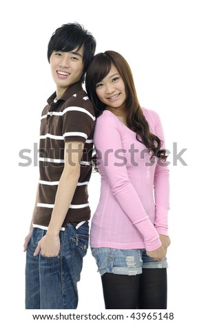 Portrait of young woman and man standing back to back
