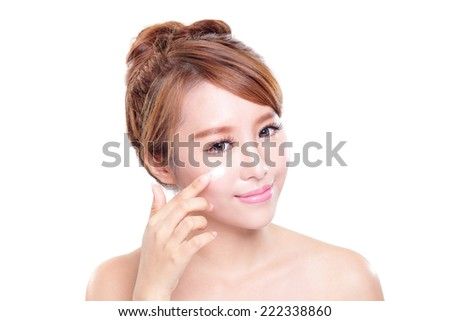 Portrait of young woman applying moisturizer cream on her pretty face isolated on white background, asian beauty - stock photo