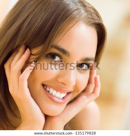 Portrait of young woman at home - stock photo