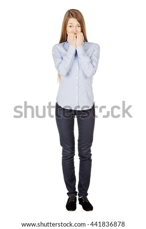 Portrait of young woman biting her nails. human emotion expression and lifestyle concept. image on a white studio background. - stock photo