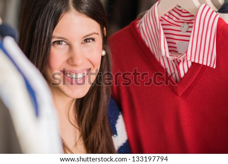 Portrait Of Young Woman Buying Shirt, Indoors