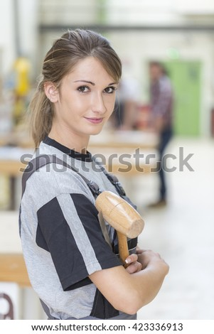 portrait of young woman carpenter