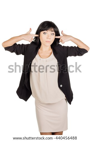 Portrait of young woman closes hands over her ears, she does not want to listen to. human emotion expression and lifestyle concept. image on a white studio background. - stock photo