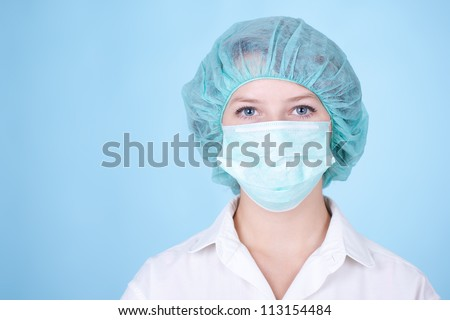 Portrait of young woman doctor surgeon or nurse. - stock photo