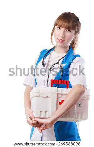 Portrait of young woman doctor with white coat standing  in hospital - stock photo