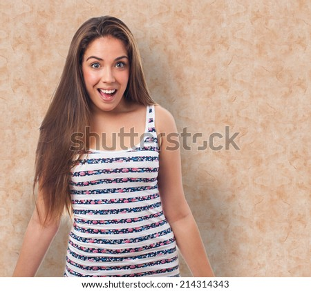 portrait of young woman  doing a surprise gesture