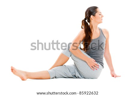 portrait of young woman doing flexibility exercise. isolated on white background - stock photo