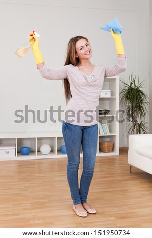 Portrait Of Young Woman Doing Household Chores - stock photo