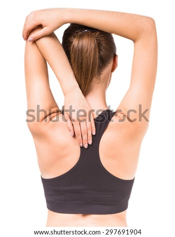Portrait of young woman doing yoga exercise. Back view. - stock photo