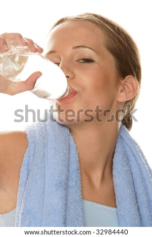 Portrait of young woman drinking bottled water isolated on white background