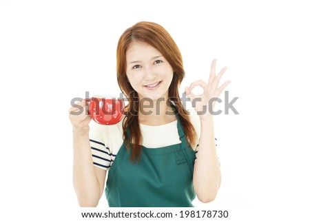 Portrait of young woman drinking coffee. - stock photo